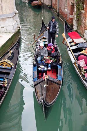 Venice - January 01: Gondoliero sailing with tourists on gondola in Venice channel, January 01, 2011, Venice, Italy