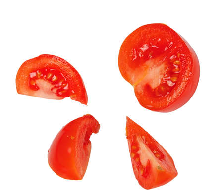 Tomato slices isolated on white photo