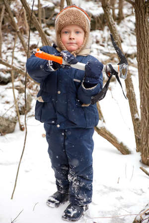ice axe: Small boy with ice axe in the forest