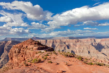 rock canyon: Grand canyon in sunny day with blue sky and clouds