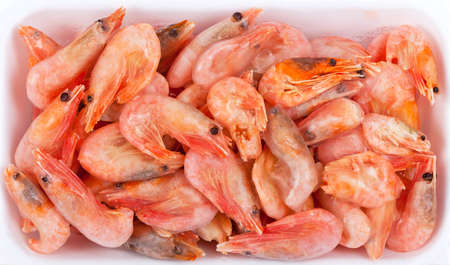 Frozen red shrimps in white box, closeup view  photo