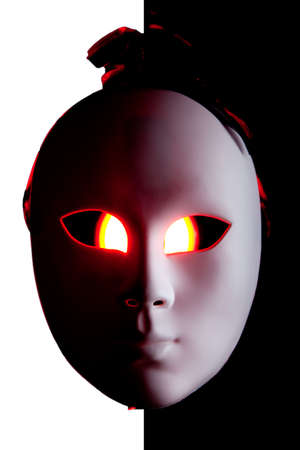 Scary black and white mask with red eyes on BW background  photo