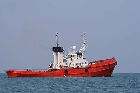 tug boat: Ocean tugboat sailing in the sea