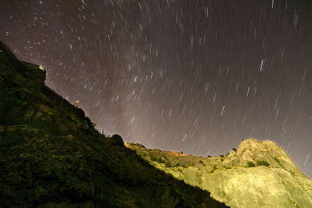 Night sky with star tracks in the mountains photo