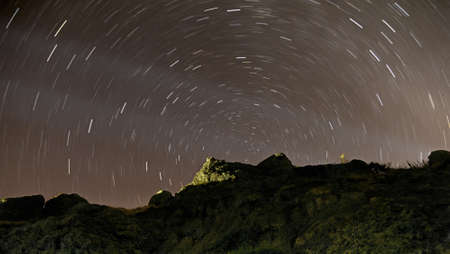 Night sky with star tracks in the mountains