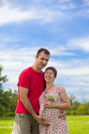 Husband hugs his pregnant wife outdoor Stock Photo - 10541562