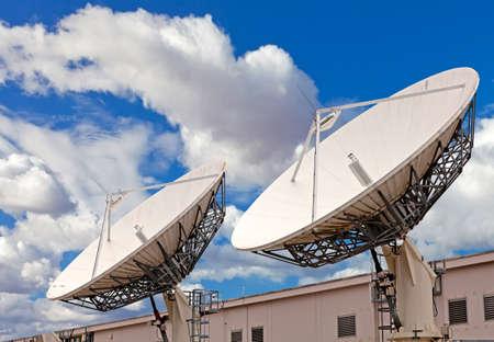 Satellite TV antenna on the roof of communication center Stockfoto