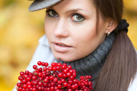 Beautiful woman portrait with viburnum berries in front  Stock Photo