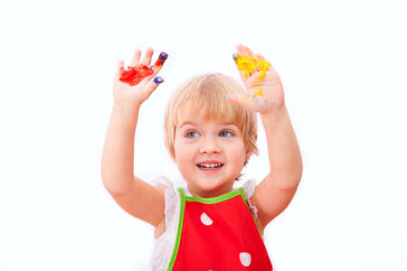 Little girl with paint on her hands isolated on white background  photo