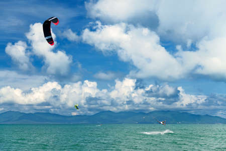 wakeboarding: Wakeboarder jumping from water in open sea. Koh Samui, Thailand