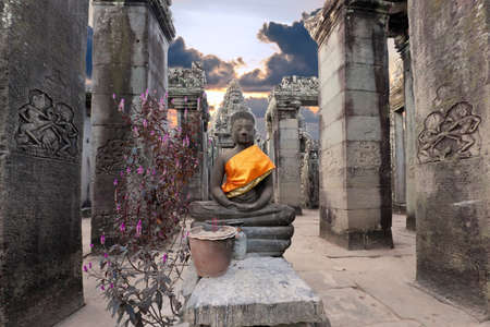 Buddha sitting in ancient temple Prasat Bayon in Angkor complex, Siem Reap, Cambodia  photo