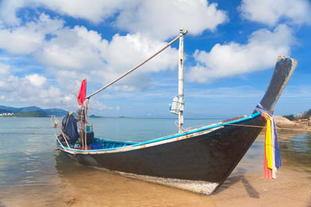 Long thai boat on sand beach, Koh Samui, Thailand  photo
