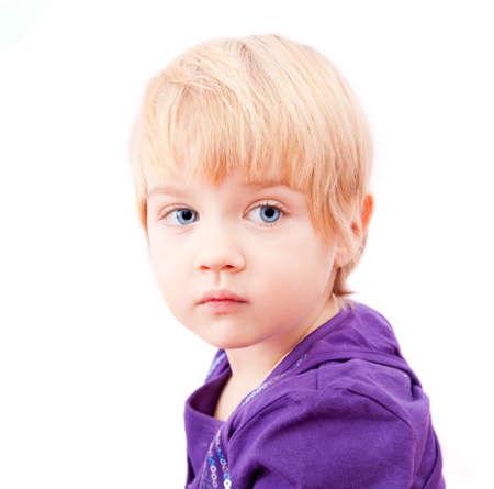 Sad little girl portrait isolated on white background  photo