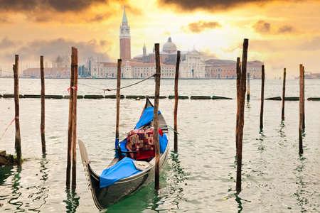 Gondola at sunset pier near San Marco square in Venice, Italy  Stock Photo
