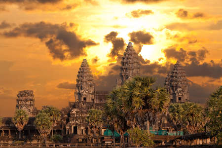 Angkor Wat temple with sunset sky and clouds