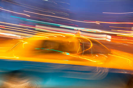 blurred lights: Taxi cab blured in motion on night city street