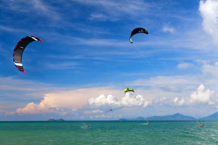 wakeboarding: Wakeboarders jumping from water in open sea. Koh Samui, Thailand  Stock Photo