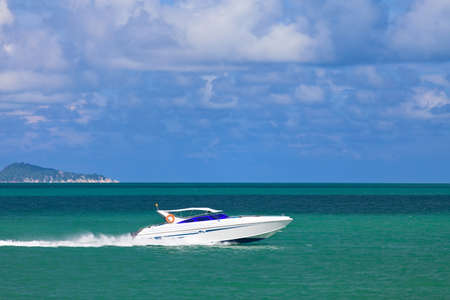 Speed boat sailing in the summer sea in Thailand  photo