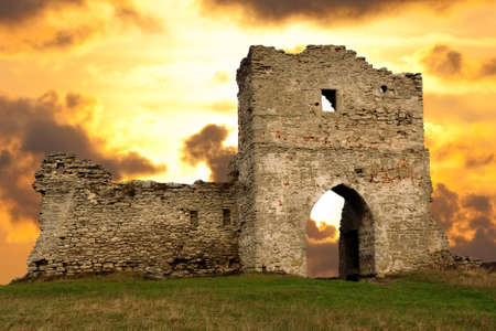 Ruined gates of cossack castle at sunset