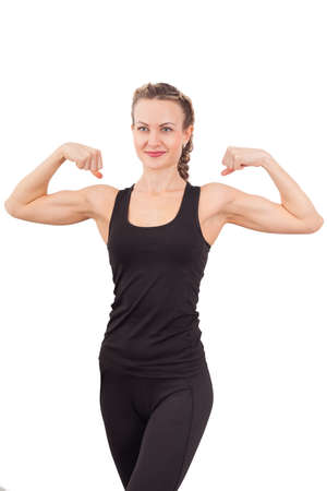 Athletic young woman showing biceps isolated on white  photo