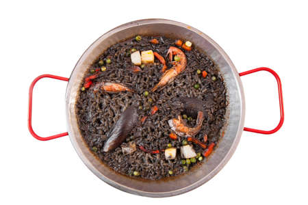 Paella negra on the pan isolated on white Stockfoto