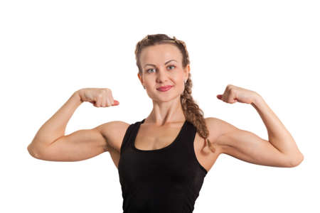 female muscle: Athletic young woman showing biceps isolated on white