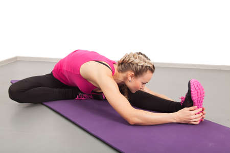 Athletic young woman doing exercises in the gym Stock Photo - 16012584