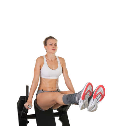 Athletic young woman training on exerciser isolated on white Stock Photo - 16012569