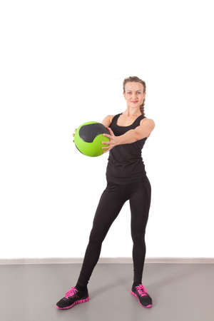 Athletic young woman training with green ball in the gym Stock Photo - 16119315