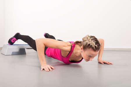 Athletic young woman doing exercises in the gym Stock Photo - 16119326