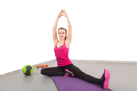 Athletic young woman doing exercises in the gym 