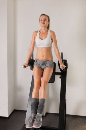 Athletic young woman training press on exerciser in the gym Stock Photo - 16119322