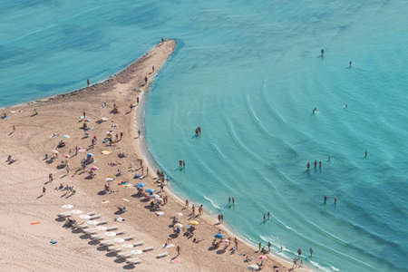 People crowd on the beach, top view, Spain photo