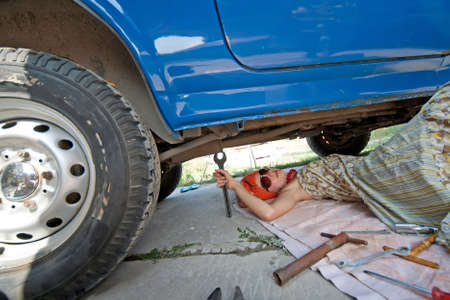 Vintage girl with tools repairing car Stock Photo - 16404800