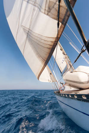 sailboat race: Sailing yacht on the race in blue sea Stock Photo