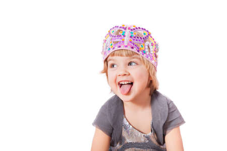 Small girl showing tongue isolated on white background  photo