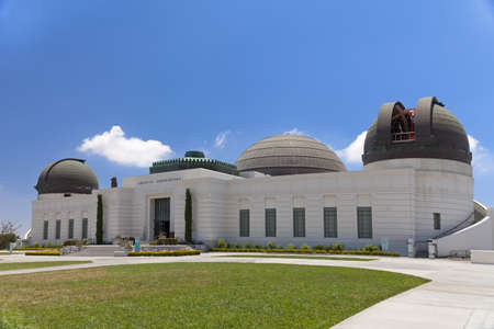 los angeles county: Griffith observatory with green grass field and sunny day Stock Photo