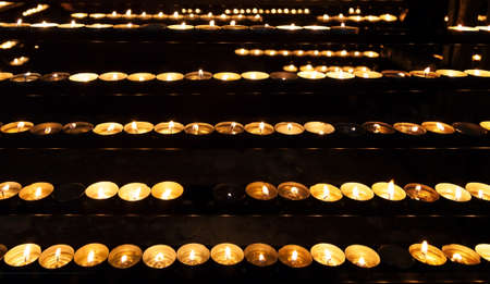 Burning candles in the St. Stephan cathedral, Vienna, Austria  photo