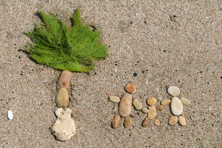 three palm trees: Happy family and palm tree made from stone on the sand beach