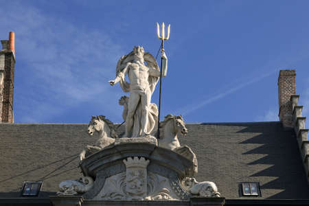 king neptune: Neptune statue on the house in Gent, Belgium  Stock Photo