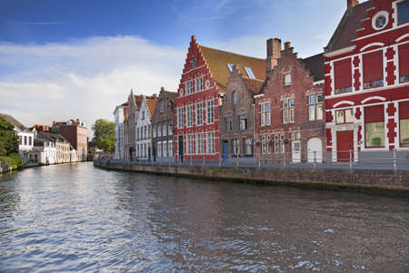 gothic window: River channel and buildings in Bruges, Belgium
