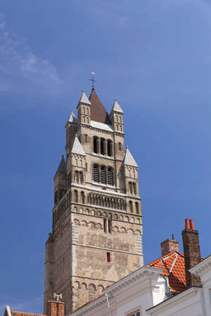 The Saint Salvador Cathedral in Bruges and roofs of old houses  photo