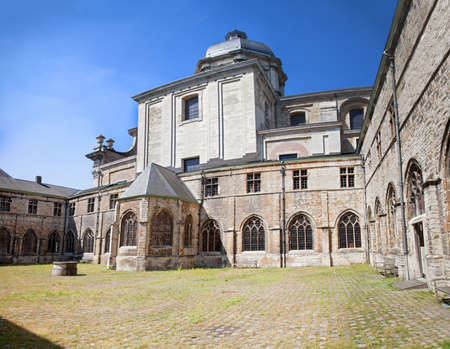 Medieval abbey yard and blue sky in Gent, Belgium  Stock Photo