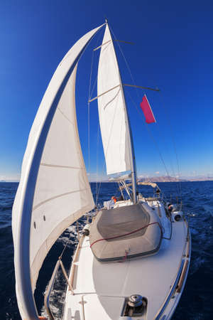 Sailing boat front view in the sea  photo