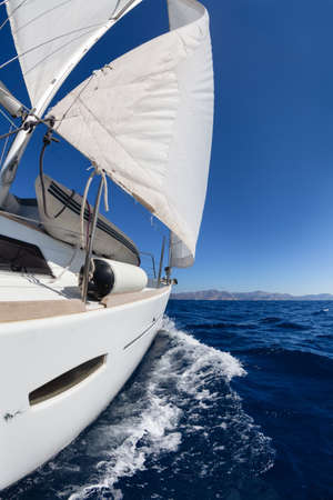sailing crew: Sailing boat wide angle view in the sea
