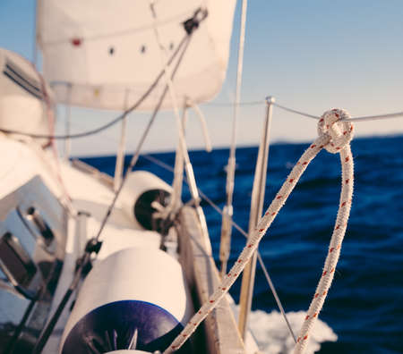 Knot on rope and sailboat crop in the sea  photo