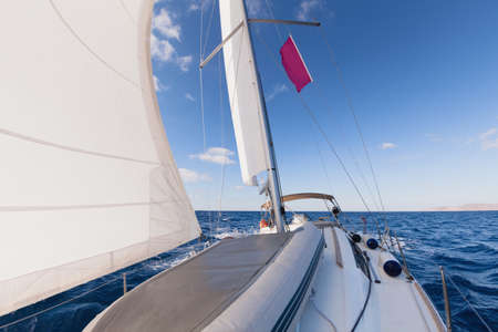 yacht race: Sailing boat front view in the sea  Stock Photo