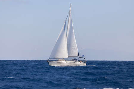 Sailing boat in open blue sea  photo