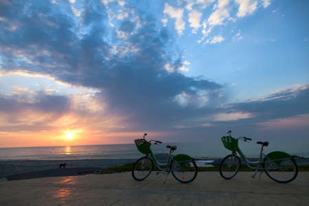 Two bicycles on Batumi beach, sunset  photo