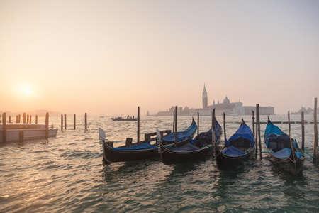 venice gondola: Venetian gondolas at sunrise in venice, Italy